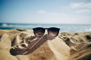 sunglasses in the sand on the beach